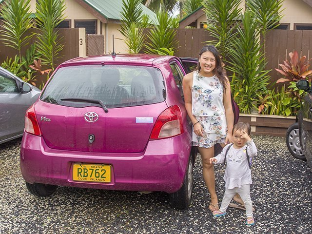Rarotonga Getting Around by Car pink toyota car with mommy and daughter standing beside it